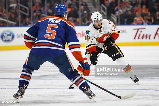 Mark Fayne of the Edmonton Oilers skates against Linden Vey of the Calgary Flames on September 26 2016 at Rogers Place in Edmonton Alberta Canada