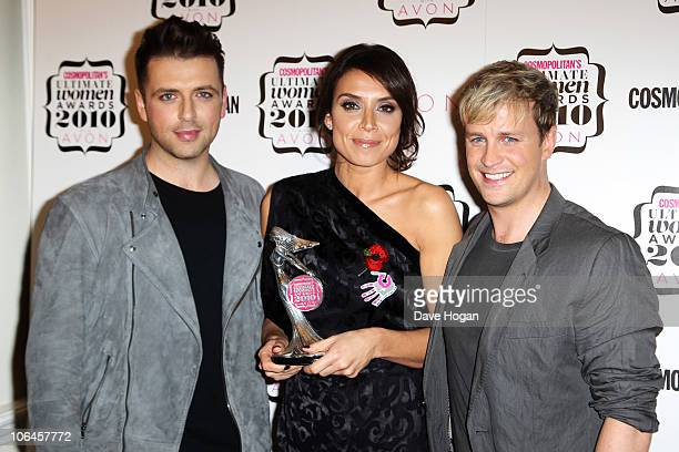 Mark Feehily and Kian Egan of Westlife pose after presenting Christine Bleakley with her Best TV Presenter award in the press room at the...