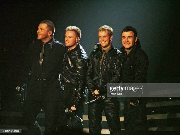 Mark Feehily Nicky Byrne Kian Egan and Shane Filan of Irish boy band Westlife perform on stage at Hammersmith Odeon on March 29th 2008 in London...