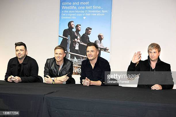 Mark Feehily Nicky Byrne Shane Filan and Kian Egan of Westlife sign copies of 'Westlife Greatest Hits' at HMV Market Street on November 21 2011 in...