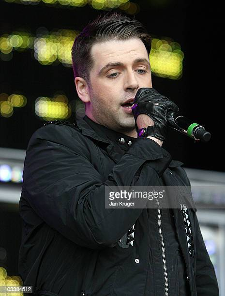 Mark Feehily of Westlife performs at Newbury Races during Ladies Day at Newbury racecourse on August 14 2010 in Newbury England