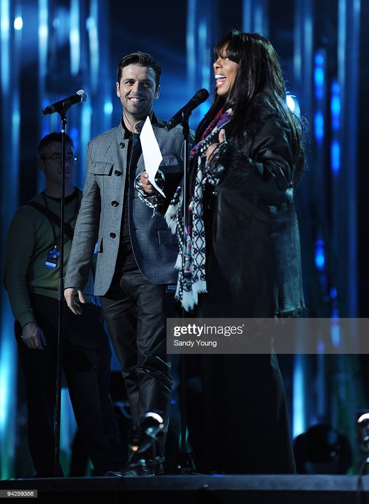 Mark Feehily of Westlife sings a duet with Donna Summer during the