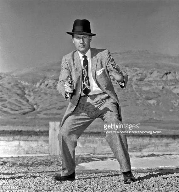 Mark Felt posing for a picture with his pistol drawn for a newspaper story in this photo taken January 20 1958 in Salt Lake City Utah An article...