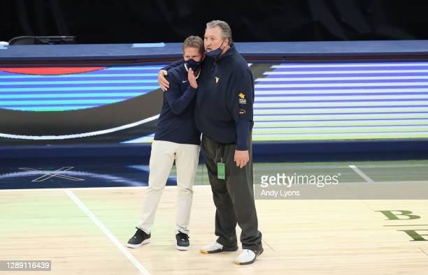 Mark Few the head coach of the Gonzaga Bulldogs and Bob Huggins the head coach of the West Virginia Mountaineers share a hug following their game at...