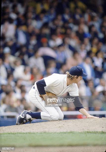 Mark Fidrych of the Detroit Tigers tends to his mound during an MLB game at Tiger Stadium in Detroit, Michigan. Mark Fidrych played for the Detroit...