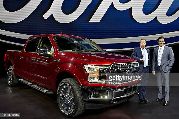 Mark Fields chief executive officer at Ford Motor Co right and Bill Ford executive chairman of Ford Motor Co stand for a photograph next to a 2018...