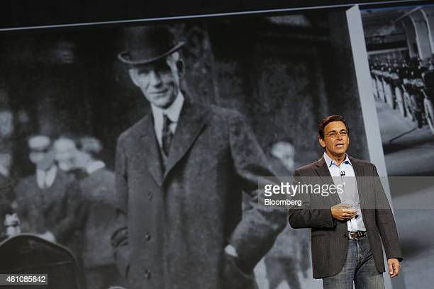 Mark Fields, chief executive officer of Ford Motor Co., speaks in front of a photo of founder Henry Ford during the 2015 Consumer Electronics Show in...