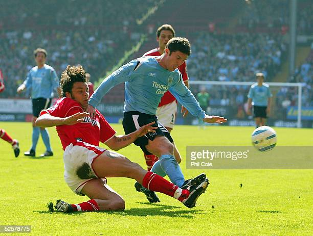 Mark Fish of Charlton slides in on Jon Macken of Manchester City during the Barclays Premiership match between Charlton Athletic and Manchester City...