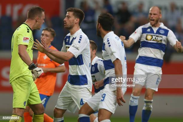 Mark Flekken of Duisburg celebrates saving a penalty with Dustin Bomheuer Simon Brandstetter and Gerrit Nauwerduring the Second Bundesliga match...