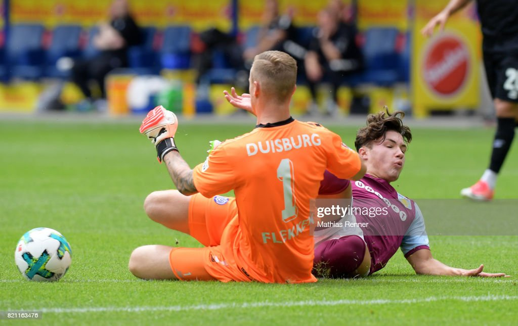 Mark Flekken of MSV Duisburg and Jack Grealish of Aston Villa during the game between Aston Villa and the MSV Duisburg on July 23, 2017 in Duisburg, Germany.