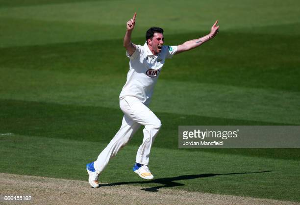 Mark Footitt of Surrey celebrates getting the wicket of Ian Bell of Warwickshire off a catch from Scott Borthwick of Surrey during day three of the...