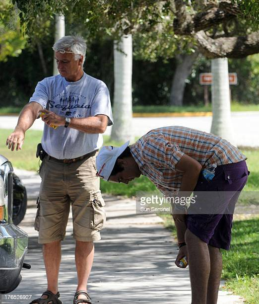 Mark Forster and his son Thomas put on insect repellent for a walk in Everglades National Park on August 8 where conditions have been perfect for...
