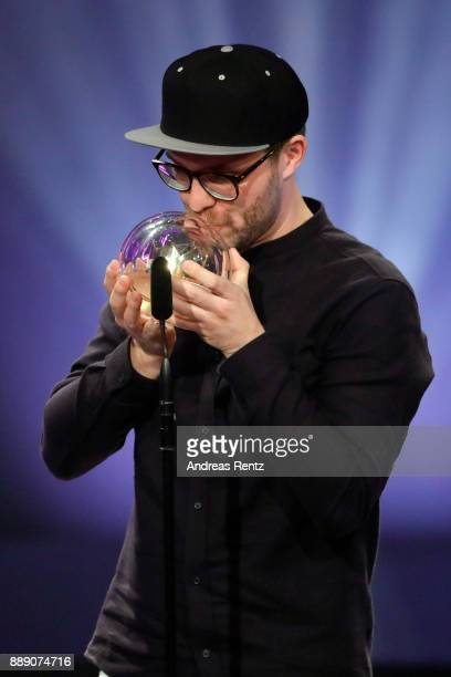 Mark Forster kisses his award for best single on stage during the 1Live Krone radio award at Jahrhunderthalle on December 07 2017 in Bochum Germany