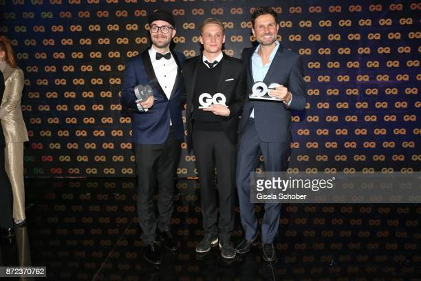 Mark Forster Matthias Schweighoefer and Simon Verhoeven with award during the show of the GQ Men of the year Award 2017 at Komische Oper on November...