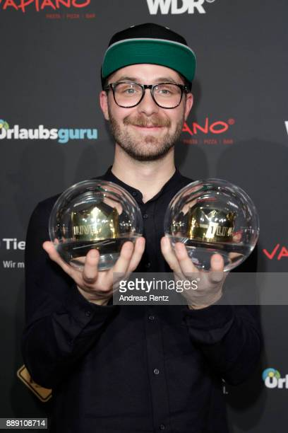 Mark Forster poses with his awards during the 1Live Krone radio award at Jahrhunderthalle on December 07 2017 in Bochum Germany
