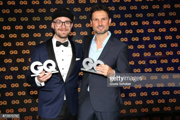 Mark Forster Simon Verhoeven with award during the show of the GQ Men of the year Award 2017 at Komische Oper on November 9 2017 in Berlin Germany
