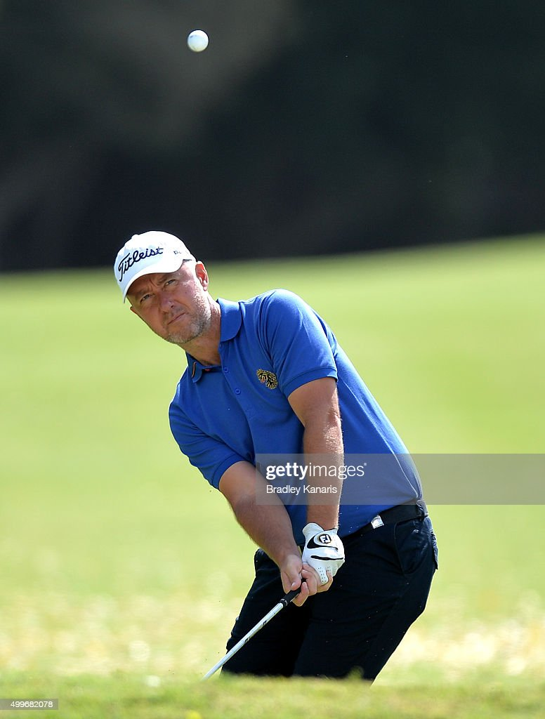 Mark Foster of England plays a shot out of the bunker on the 11th hole during day one of the 2015 Australian PGA Championship at Royal Pines Resort on December 3, 2015 in Gold Coast, Australia.