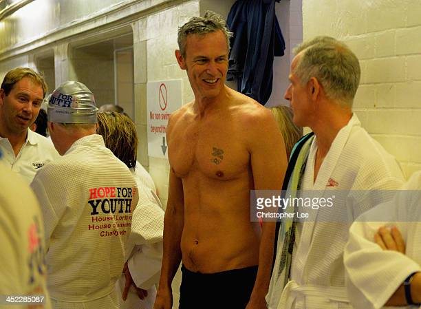Mark Foster talks to Lord Brian Paddick during the The House of Lords v House of Commons Speedo Charity Swim at Porchester Hall on November 27 2013...