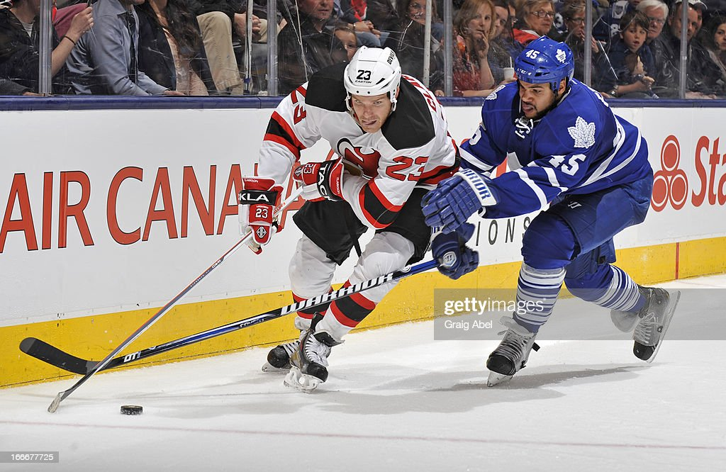 Mark Fraser #45 of the Toronto Maple Leafs battles for the puck with David Clarkson #23 of the New Jersey Devils during NHL game action April 15, 2013 at the Air Canada Centre in Toronto, Ontario, Canada.
