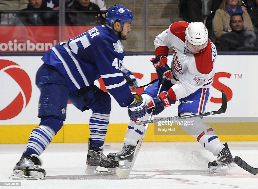Mark Fraser #45 of the Toronto Maple Leafs battles with Alex Galchenyuk #27 of the Montreal Canadiens during NHL game action February 27, 2013 at the Air Canada Centre in Toronto, Ontario, Canada.