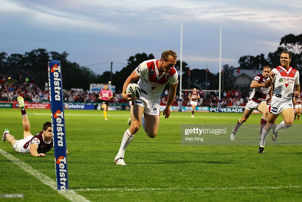 Mark Gasnier of the Dragons crosses the line to score a try during the NRL Fourth Qualifying Final match between the St George Illawarra Dragons and the Manly Warringah Sea Eagles at WIN Jubilee Stadium on September 12, 2010 in Sydney, Australia.