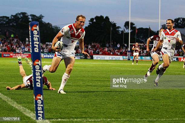 Mark Gasnier of the Dragons crosses the line to score a try during the NRL Fourth Qualifying Final match between the St George Illawarra Dragons and...