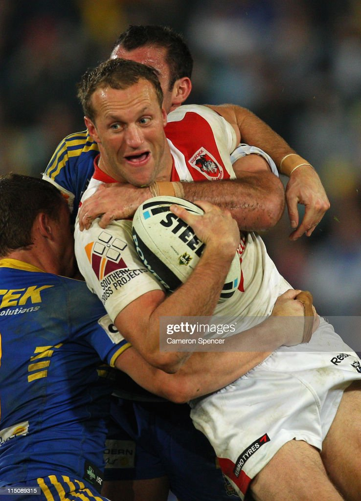 Mark Gasnier of the Dragons is tackled during the round 13 NRL match between the Parramatta Eels and the St George Illawarra Dragons at Parramatta Stadium on June 3, 2011 in Sydney, Australia.