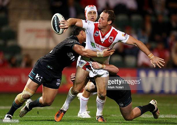 Mark Gasnier of the Dragons offloads during the round 26 NRL match between the St George Illawarra Dragons and the Penrith Panthers at WIN Stadium on...