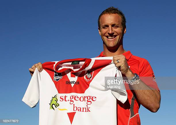 Mark Gasnier poses with a Dragons jersey at a NRL press conference after signing with the St George Illawarra Dragons at WIN Jubilee Stadium on June...