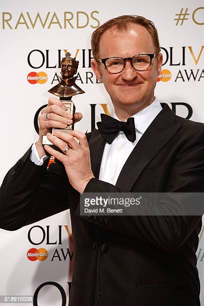 Mark Gatiss winner of the Best Actor In A Supporting Role award for Three Days In The Country poses in the Winners Room at The Olivier Awards with...