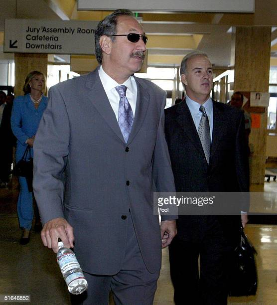 Mark Geragos and Pat Harris , attorneys for accused double-murderer Scott Peterson, enter the San Mateo County Superior Courthouse for closing...