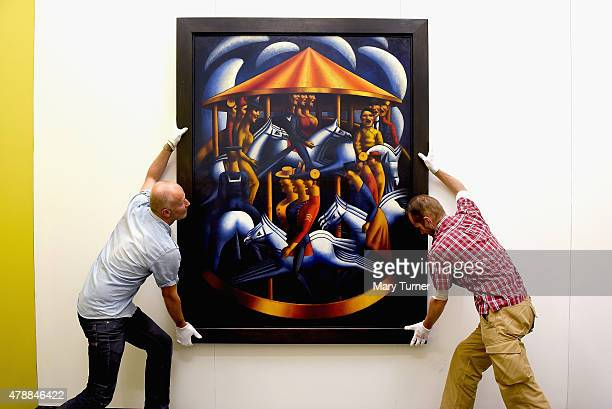 Mark Gertler's MerryGoAround is installed by gallery assistants as it returns to Ben Uri on loan for the first time since its sale to Tate in 1984...