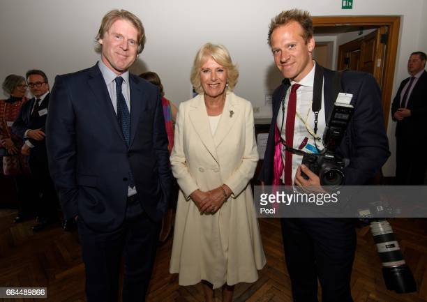Mark Getty Camilla Duchess of Cornwall and Royal photographer Christopher Jackson pose for a photograph at The British School on April 4 2017 in Rome...