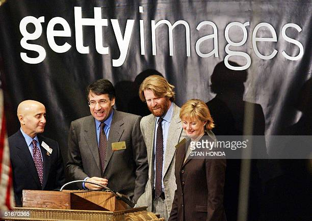 Mark Getty, Chairman of Getty Images , smiles after ringing the opening bell of the New York Stock Exchange with company CEO Jonathan Klein , chief...