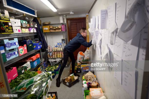 Mark Gilman manager of the community owned grocery shop The Village Green checks an emailed order from a local resident selfisolating amidst the...