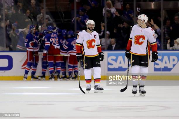 Mark Giordano and Mark Jankowski of the Calgary Flames react after the go ahead goal by Mika Zibanejad of the New York Rangers in the third period...