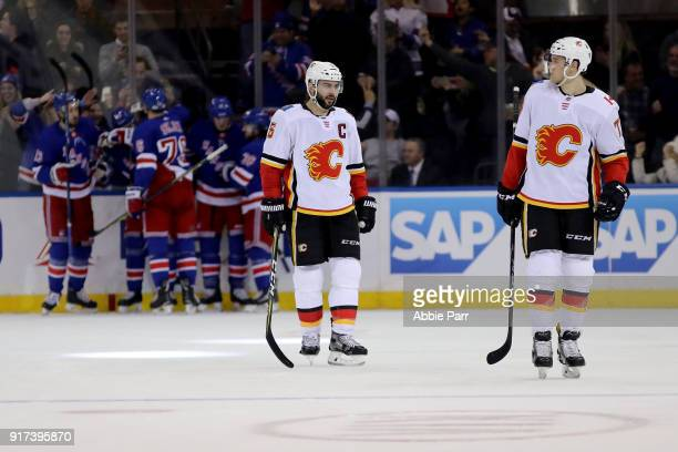 Mark Giordano and Mark Jankowski of the Calgary Flames react after the goahead goal by Mika Zibanejad of the New York Rangers in the third period...
