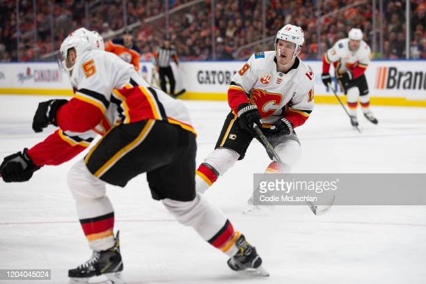 Mark Giordano and Matthew Tkachuk of the Calgary Flames skate against the Edmonton Oilers at Rogers Place on January 29 in Edmonton Canada