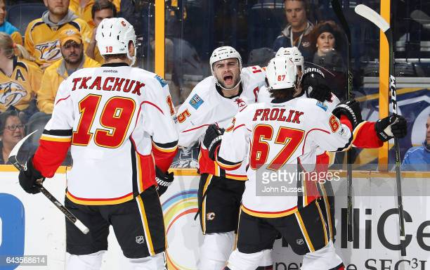 Mark Giordano celebrates a goal with Michael Frolik Mikael Backlund and Matthew Tkachuk of the Calgary Flames against the Nashville Predators during...