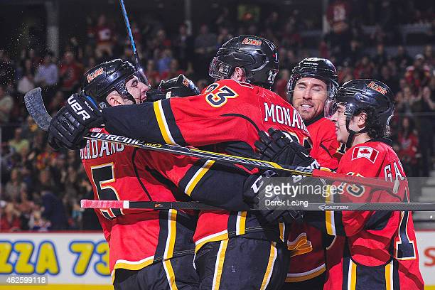 Mark Giordano congratulates Sean Monahan after he scored against the Edmonton Oilers during an NHL game at Scotiabank Saddledome on January 31 2015...