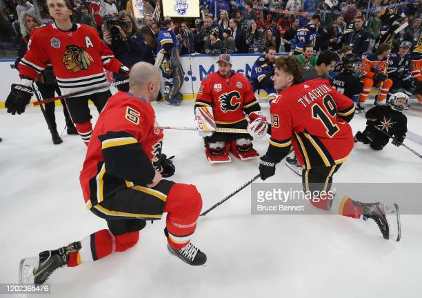 Mark Giordano David Rittich and Matthew Tkachuk of the Calgary Flames stretch during the 2020 NHL AllStar Skills competition at the Enterprise Center...