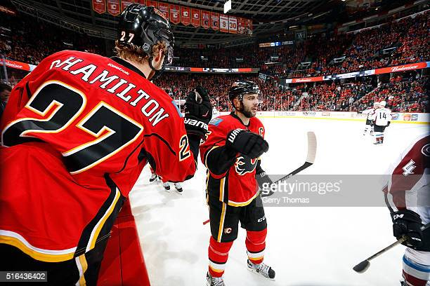 Mark Giordano Dougie Hamilton and teammates of the Calgary Flames celebrate a goal against the Colorado Avalanche during an NHL game at Scotiabank...