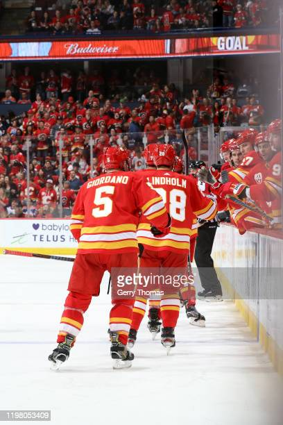 Mark Giordano Elias Lindholm and teammates of the Calgary Flames celebrates a goal against the Edmonton Oilers at Scotiabank Saddledome on February...