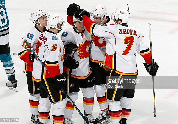 Mark Giordano Johnny Gaudreau Jiri Hudler Sean Monahan and TJ Brodie of the Calgary Flames celebrate after a goal against the San Jose Sharks during...