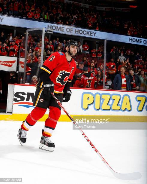 Mark Giordano of the Calgary Flames acknowledges the home crowd after his team's 71 win over the Arizona Coyotes in his 800th NHL game on January 13...