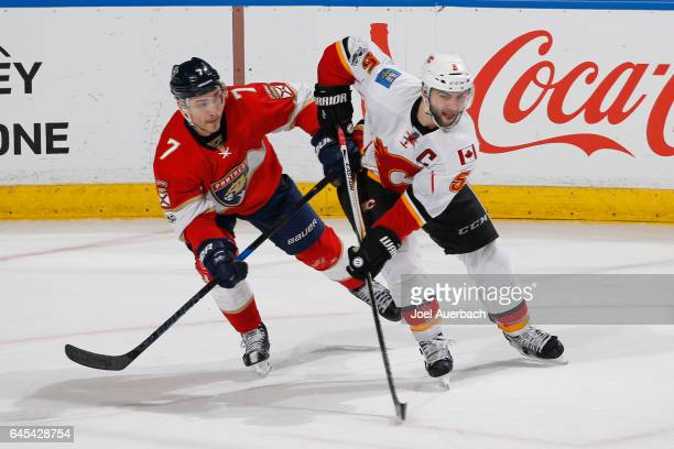 Mark Giordano of the Calgary Flames and Colton Sceviour of the Florida Panthers battle for position at the BBT Center on February 24 2017 in Sunrise...