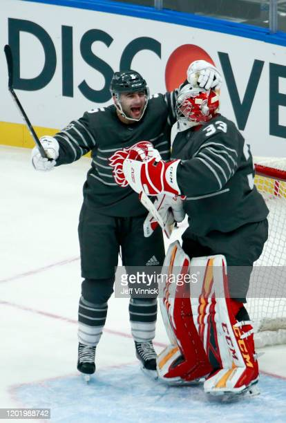Mark Giordano of the Calgary Flames and David Rittich of the Calgary Flames celebrate after the 2020 NHL AllStar Game between the Atlantic Division...