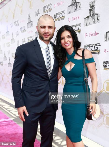Mark Giordano of the Calgary Flames and guest arrive on the magenta carpet for the 2017 NHL Awards at TMobile Arena on June 21 2017 in Las Vegas...