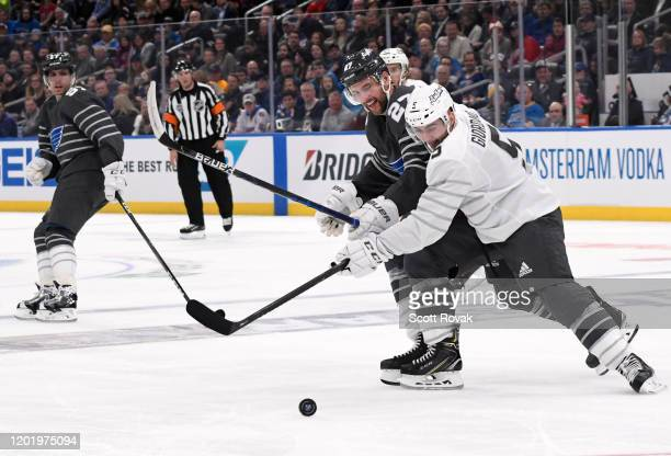 Mark Giordano of the Calgary Flames battles for the puck against Alex Pietrangelo of the St Louis Blues during the 2020 NHL AllStar Game between the...
