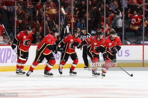 Mark Giordano of the Calgary Flames celebrates a goal against the Arizona Coyotes with Sean Monahan Johnny Gaudreau Rasmus Andersson and Matthew...